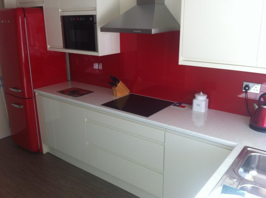 Lucente cream gloss kitchen with red splashback and Smeg fridge