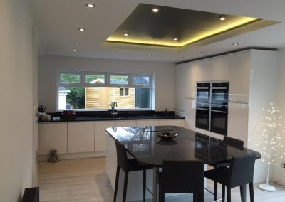 Kitchen: Strada Handleless White Gloss with Granite Worktops