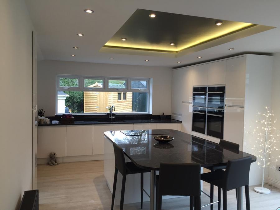 Kitchen: Strada Handleless White Gloss with Granite Worktops